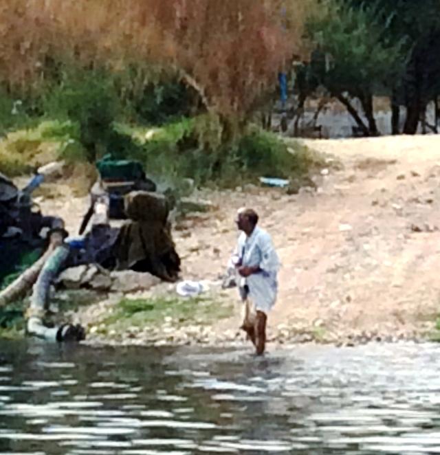 Man taking his daily bath in the Nile near Luxor