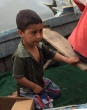 Egyptian boy in fishing boat